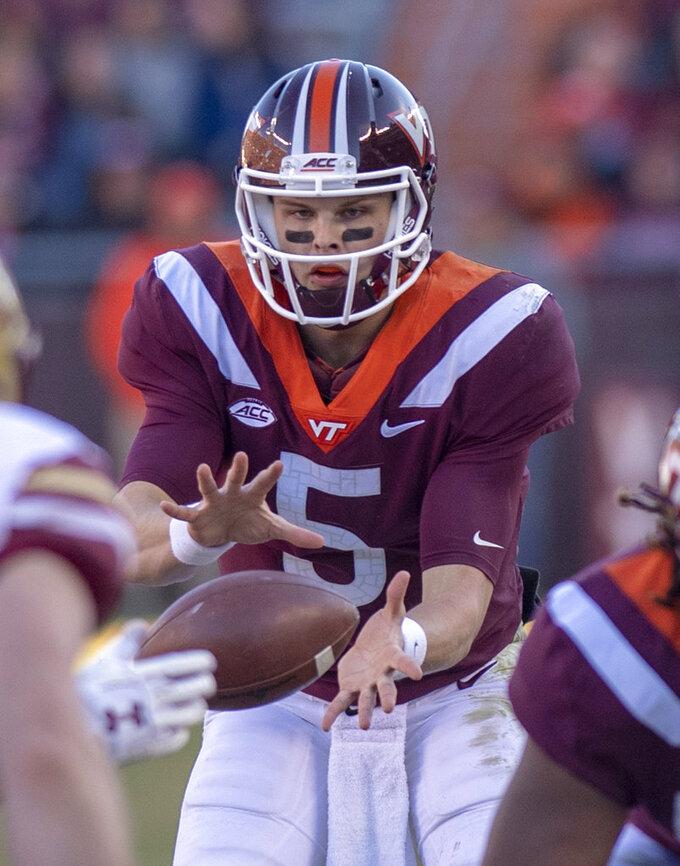 Virginia Tech quarterback Ryan Willis takes a snap  during the first half of an NCAA college football game against Boston College in Blacksburg, Va., Saturday, Nov. 3, 2018. (AP Photo/Matt Bell)