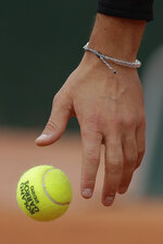 Austria's Dominic Thiem serves against Jack Sock of the U.S. in the second round match of the French Open tennis tournament at the Roland Garros stadium in Paris, France, Wednesday, Sept. 30, 2020. (AP Photo/Alessandra Tarantino)