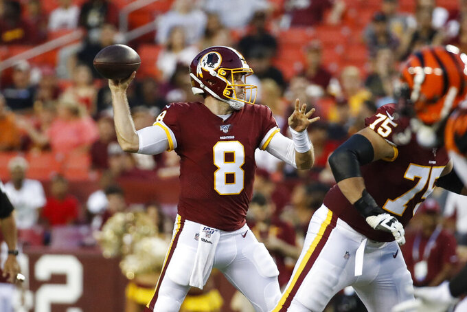 Washington Redskins quarterback Case Keenum (8) throws during the first half of the team's NFL preseason football game against the Cincinnati Bengals, Thursday, Aug. 15, 2019, in Landover, Md. (AP Photo/Alex Brandon)