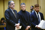 Fotis Dulos, center, and his attorneys Norm Pattis, left and Chris La Tronica appear for a probable cause hearing in Stamford Superior Court, Thursday, Jan. 23, 2020, in Stamford, Conn. Dulos, the estranged husband of Jennifer Dulos, a missing Connecticut mother of five who is presumed dead, pleaded not guilty Thursday to murder and kidnapping charges as a judge warned him to not violate his house arrest conditions again. (Erik Trautmann/Hearst Connecticut Media via AP, Pool)