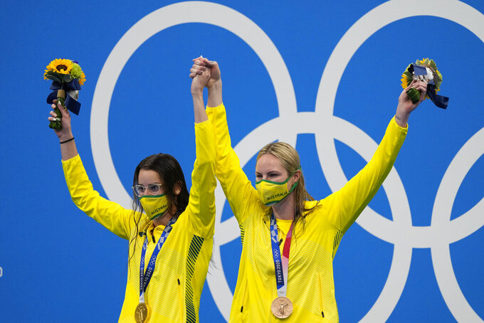Kaylee Mckeown, of Australia, left, poses with teammate Emily Seebohm after winning the gold medal in the women's 200-meter backstroke final at the 2020 Summer Olympics, Saturday, July 31, 2021, in Tokyo, Japan. Seebohm won the bronze medal. (AP Photo/Jae C. Hong)