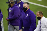 Northwestern head coach Pat Fitzgerald, center, walks off the field after a 21-20 victory over Iowa in an NCAA college football game, Saturday, Oct. 31, 2020, in Iowa City, Iowa. (AP Photo/Charlie Neibergall)