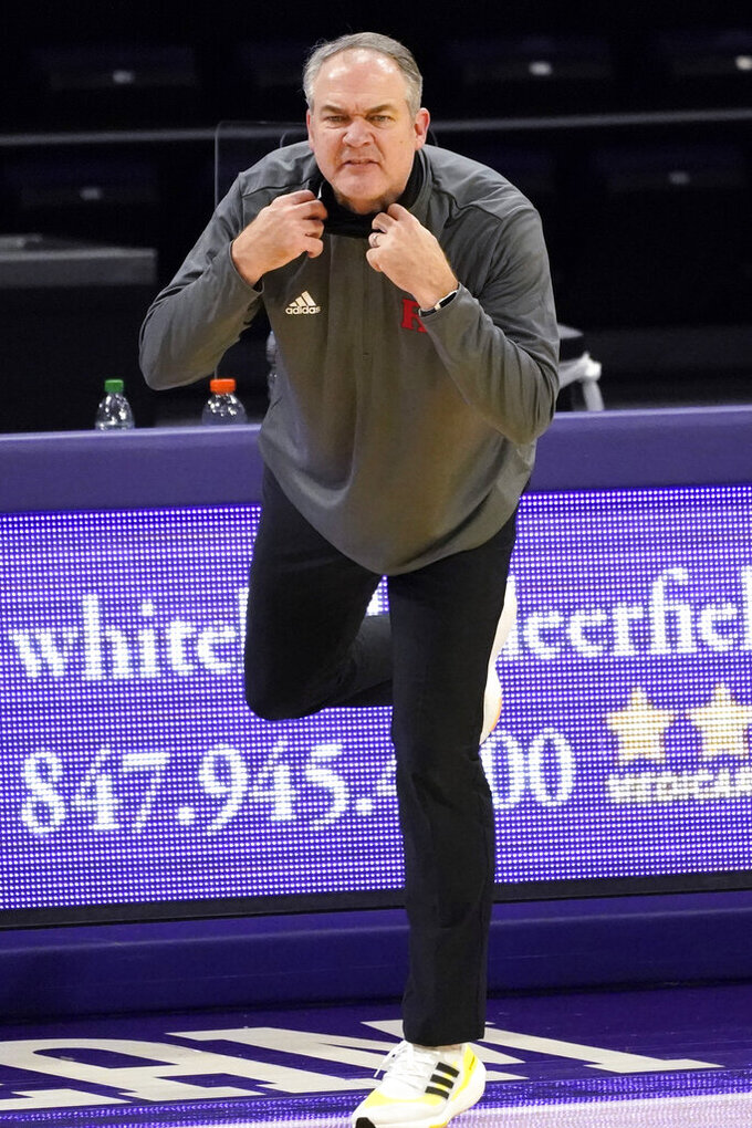 Rutgers head coach Steve Pikiell watches his team during the first half of an NCAA college basketball game against Northwestern in Evanston, Ill., Sunday, Jan. 31, 2021. (AP Photo/Nam Y. Huh)
