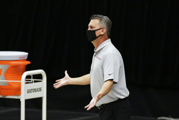 Washington State coach Kyle Smith reacts during the first half of the team's NCAA college basketball game against Oregon State in Pullman, Wash., Wednesday, Dec. 2, 2020. (AP Photo/Young Kwak)