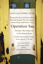 This Dec. 3, 2019, photo shows a sign posted on the door of the public school in Napakiak, Alaska. The Alaska National Guard brought its Operation Santa Claus to the western Alaska community, which is being severely eroded by the nearby Kuskokwim River. (AP Photo/Mark Thiessen)