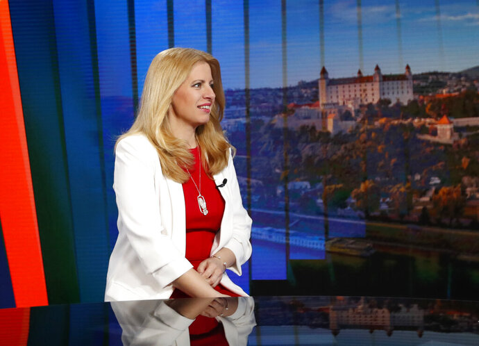 FILE - In this Sunday, March 31, 2019 file photo, Slovakia's newly elected President Zuzana Caputova attends a TV debate in Bratislava, Slovakia. Slovakia's president has told China's foreign minister she is worried about human rights in his country. Caputova met with Chinese Foreign Minister Wang Yi in the Slovak capital of Bratislava on Wednesday, July 10, 2019. (AP Photo/Petr David Josek, file)
