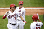 Washington Nationals' Trea Turner (7) celebrates his grand slam with Andrew Stevenson, center, and Jake Noll, right, during the third inning of a baseball game against the New York Mets, Sunday, Sept. 27, 2020, in Washington. (AP Photo/Nick Wass)
