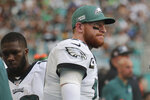 Philadelphia Eagles quarterback Carson Wentz (11) looks up during the end of the second half at an NFL football game, Sunday, Dec. 1, 2019, in Miami Gardens, Fla. The Dolphins defeated the Eagles 37-31. (AP Photo/Lynne Sladky)