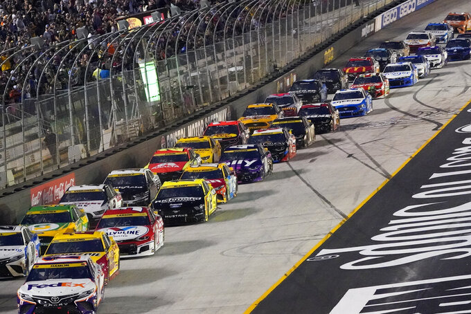 Cars take the green flag to start a NASCAR Cup Series auto race at Bristol Motor Speedway Saturday, Sept. 18, 2021, in Bristol, Tenn. (AP Photo/Mark Humphrey)