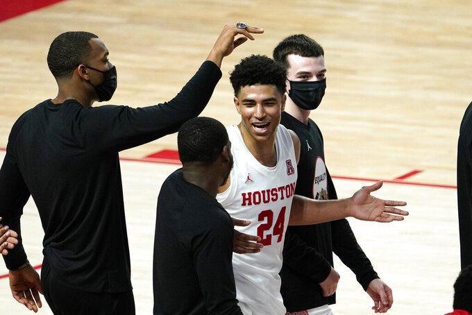 Houston's Quentin Grimes (24) celebrates with teammates after an NCAA college basketball game against the Wichita State Wednesday, Jan. 6, 2021, in Houston. Houston won 70-63. (AP Photo/David J. Phillip)