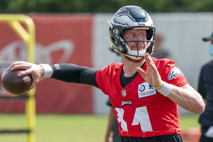 Philadelphia Eagles quarterback Carson Wentz throws the ball during an NFL football practice, Sunday, Aug. 23, 2020, in Philadelphia. (AP Photo/Chris Szagola, Pool)