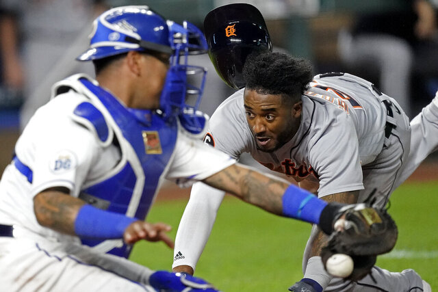 Detroit Tigers' Niko Goodrum beats the throw to Kansas City Royals catcher Salvador Perez to score on a sacrifice fly by Eric Haase during the seventh inning of a baseball game Friday, Sept. 25, 2020, in Kansas City, Mo. (AP Photo/Charlie Riedel)