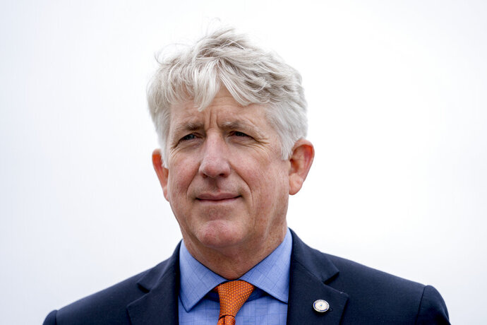 FILE - In this Feb. 26, 2018 file photo, Virginia Attorney General Mark Herring attends a news conference near the White House in Washington. Herring is calling for the legalization of marijuana. He said Saturday, June 15, 2019, that Virginia should start decriminalizing possession of small amounts of marijuana and eventually legalize the drug. (AP Photo/Andrew Harnik, File)