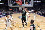 Boston Celtics center Daniel Theis (27) goes to the basket over New Orleans Pelicans center Jaxson Hayes (10) in the first half of an NBA basketball game in New Orleans, Sunday, Jan. 26, 2020. (AP Photo/Gerald Herbert)