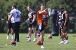 Cincinnati Bengals' Joe Burrow stretches during NFL football practice in Cincinnati, Tuesday, May 25, 2021. (AP Photo/Aaron Doster)