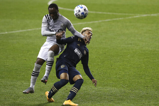 Matt Real, right, of the Philadelphia Union and Ballou Tabla, left, of the Montreal Impact battle for the ball in the 2nd half. The Philadelphia Union becomes the first Philadelphia-area team to allow fans in the stands for their game against Montreal on Oct. 11, 2020, in Chester, Pa. (Charles Fox/The Philadelphia Inquirer via AP)