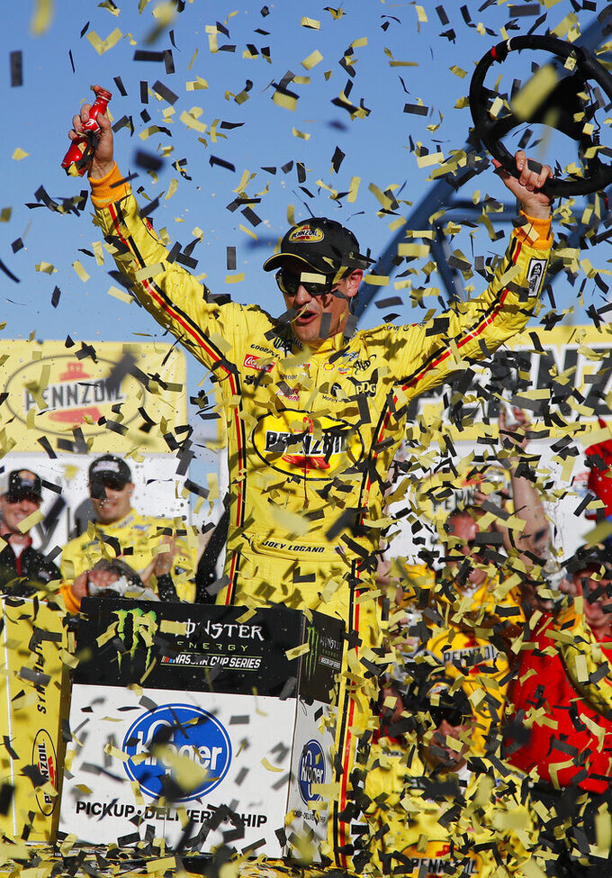 Joey Logano celebrates after winning a NASCAR Cup Series auto race at Las Vegas Motor Speedway, Sunday, March 3, 2019, in Las Vegas. (AP Photo/John Locher)