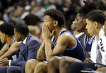 Rhode Island's Dana Tate, center, reacts with teammates on the bench during the second half of an NCAA college basketball game against St. Bonaventure in the semifinal round of the Atlantic 10 men's tournament Saturday, March 16, 2019, in New York. St. Bonaventure won 68-51. (AP Photo)