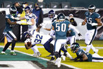 Seattle Seahawks' Chris Carson (32) scores a touchdown during the first half of an NFL football game against the Philadelphia Eagles, Monday, Nov. 30, 2020, in Philadelphia. (AP Photo/Chris Szagola)