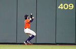 Houston Astros center fielder Jake Marisnick catches a fly ball by Boston Red Sox's Andrew Benintendi during the ninth inning of a baseball game Friday, May 24, 2019, in Houston. The Astros won 4-3. (AP Photo/David J. Phillip)