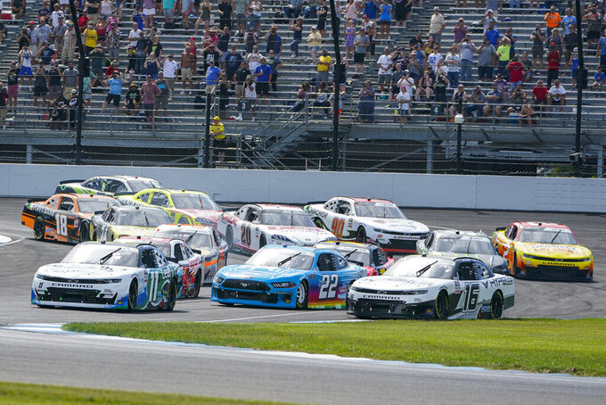 Justin Haley (11) leads the field on the start of the NASCAR Xfinity Series auto race at Indianapolis Motor Speedway in Indianapolis, Saturday, Aug. 14, 2021. (AP Photo/Michael Conroy)