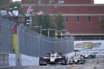 Marcus Ericsson (8) takes the checkered flag during the IndyCar Music City Grand Prix auto race Sunday, Aug. 8, 2021, in Nashville, Tenn. (AP Photo/Harrison McClary)