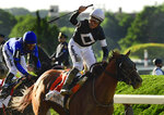 Jockey Joel Rosario reacts atop Sir Winston (7) after winning the 151st running of the Belmont Stakes horse race , Saturday, June 8, 2019, in Elmont, N.Y. (AP Photo/Steven Ryan)