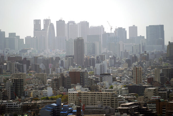 Landscape is seen in Tokyo on March 31, 2021. The Japanese economy contracted at an annual rate of 5.1% in January-March, slammed by a plunge in spending over the coronavirus pandemic, according to government data released Tuesday, May 18, 2021. (AP Photo/Eugene Hoshiko)