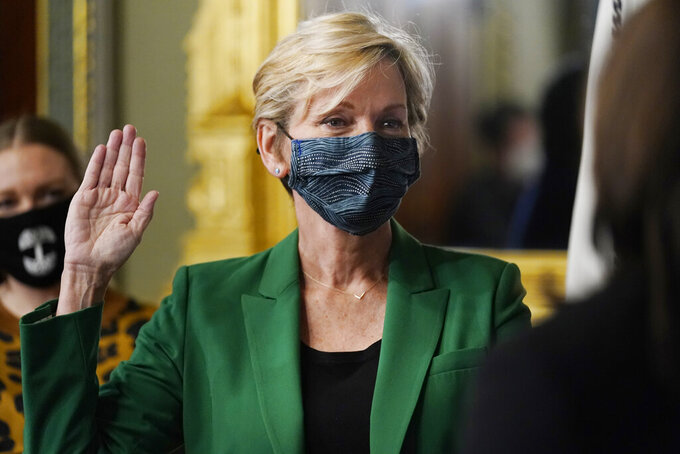 Former Michigan Governor Jennifer Granholm is is sworn in as Energy Secretary by Vice President Kamala Harris in the Old Executive Office Building in the White House complex in Washington, Thursday, Feb. 25, 2021. (AP Photo/Andrew Harnik)