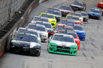 Kyle Busch (18) leads Austin Cindric (22) and the rest of the field down the back stretch during a NASCAR Xfinity Series auto race Friday, Aug. 16, 2019, in Bristol, Tenn. (AP Photo/Wade Payne)