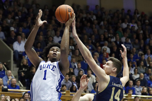 Duke center Vernon Carey Jr. (1) shoots while Notre Dame forward Nate Laszewski (14) defends during the second half of an NCAA college basketball game in Durham, N.C., Saturday, Feb. 15, 2020. (AP Photo/Gerry Broome)