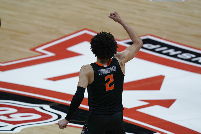 Oklahoma State's Cade Cunningham celebrates after a basket during the second half of an NCAA college basketball game against Baylor in the semifinals of the Big 12 tournament in Kansas City, Mo., Friday, March 12, 2021. (AP Photo/Charlie Riedel)