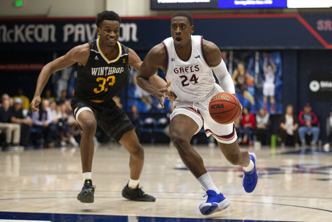 Saint Mary's forward Malik Fitts (24) drives to the basket past Winthrop forward Chase Claxton (33) during the first half of an NCAA college basketball game, Monday, Nov. 11, 2019 in Moraga, Calif. (AP Photo/D. Ross Cameron)