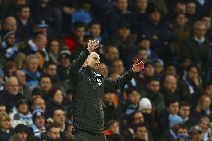 Manchester City's head coach Pep Guardiola gestures during the English League Cup semifinal second leg soccer match between Manchester City and Manchester United at Etihad stadium in Manchester, England, Wednesday, Jan. 29, 2020. (AP Photo/Dave Thompson)