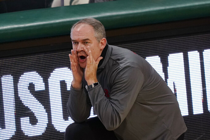 Rutgers head coach Steve Pikiell yells from the sideline during the first half of an NCAA college basketball game against Michigan State, Tuesday, Jan. 5, 2021, in East Lansing, Mich. (AP Photo/Carlos Osorio)