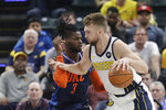 Indiana Pacers' Domantas Sabonis (11) goes to the basket against Oklahoma City Thunder's Nerlens Noel (3) during the first half of an NBA basketball game, Thursday, March 14, 2019, in Indianapolis. (AP Photo/Darron Cummings)