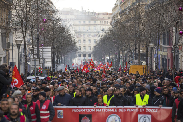 Strikers march during a demonstration Tuesday, Jan. 14, 2020, in Marseille, southern France. Rail workers, teachers, doctors, lawyers and others joined another nationwide day of protests and strikes Tuesday to denounce French President Emmanuel Macron's plans to overhaul the pension system. (AP Photo/Daniel Cole)
