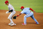 Los Angeles Angels' Shohei Ohtani, left, slides in safely at second base ahead of the tag by Texas Rangers shortstop Elvis Andrus, right, for a double in the sixth inning of a baseball game in Arlington, Texas, Sunday, Aug. 9, 2020. (AP Photo/Ray Carlin)
