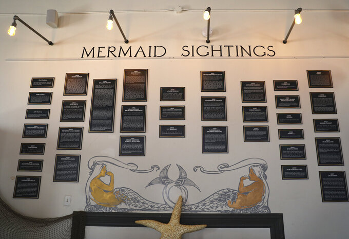 Plaques commemorating mermaid sightings are displayed  at the Mermaid Museum, Tuesday, July 20, 2021, in Berlin, Md. (Lauren Roberts/The Daily Times via AP)