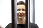 Belarus' opposition activists Maria Kolesnikova attends a court hearing in Minsk, Belarus, Wednesday, Aug. 4, 2021. Kolesnikova resisted the authorities' attempts to force her to leave Belarus and ripped her passport when officers of the Belarusian security agency tried to forcibly expel her in September of 2020. (Ramil Nasibulin/BelTA pool photo via AP)