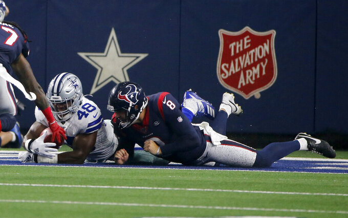 Dallas Cowboys linebacker Joe Thomas (48) recovers a blocked punt-attempt by Houston Texans' Trevor Daniel (8) in the end zone for a Cowboys touchdown in the first first half of a preseason NFL football game in Arlington, Texas, Saturday, Aug. 24, 2019. (AP Photo/Michael Ainsworth)