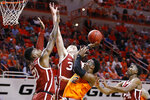 Oklahoma State forward Cameron McGriff (12) shoots between Oklahoma forward Kristian Doolittle (21), Brady Manek, rear, and Jamal Bieniemy (24) in the first half of an NCAA college basketball game in Stillwater, Okla., Saturday, Feb. 22, 2020. (AP Photo/Sue Ogrocki)