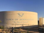 A seal of Bernalillo, New Mexico, with a Spanish conquistador helmet and a colonial ax sits on a town water tank along New Mexico Highway 550 on Tuesday, June 30, 2020. Roger Fragua, a Jemez Pueblo member and executive director of the nonprofit group Flower Hill Institute, sent a letter to the town of Bernalillo on June 17, 2020, asking the mayor to talk about the large depiction on the state highway that runs through many Pueblo lands. Many Native Americans find conquistador imagery offensive. (AP Photo/ Russell Contreras)