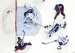Columbus Blue Jackets' Oliver Bjorkstrand, bottom left, of Denmark, scores against Tampa Bay Lightning's Andrei Vasilevskiy, of Russia, during the second period of Game 4 of an NHL hockey first-round playoff series, Tuesday, April 16, 2019, in Columbus, Ohio. (AP Photo/Jay LaPrete)