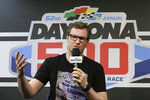 FILE - This Feb. 16, 2020, file photo shows Dale Earnhardt Jr. answering questions during a news conference before the NASCAR Daytona 500 auto race at Daytona International Speedway in Daytona Beach, Fla. Earnhardt Jr. and a pilot struggled to open a crashed airplane's rear exit door as the aircraft began to burn and fill with smoke before the race car driver and his family managed to escape from the main door, according to new details about the 2019 accident released by the National Transportation and Safety Board. (AP Photo/Terry Renna, File)