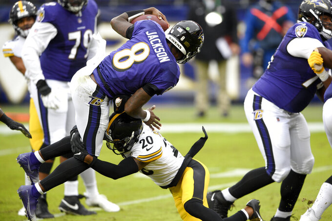 Pittsburgh Steelers cornerback Cameron Sutton (20) makes a hit on Baltimore Ravens quarterback Lamar Jackson (8) as he scrambles for yardage during the first half of an NFL football game, Sunday, Nov. 1, 2020, in Baltimore. (AP Photo/Nick Wass)