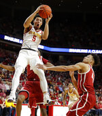 Iowa State guard Lindell Wigginton (5) grabs a rebound over Oklahoma center Jamuni McNeace, right, during the second half of an NCAA college basketball game, Monday, Feb. 25, 2019, in Ames, Iowa. (AP Photo/Charlie Neibergall)