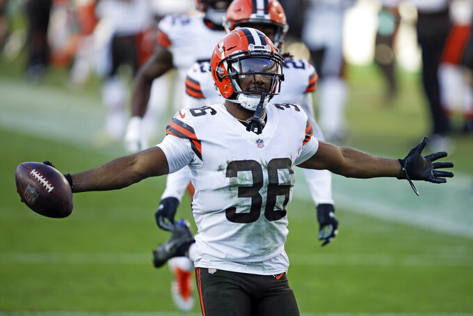 Cleveland Browns cornerback M.J. Stewart (36) celebrates after intercepting a pass against the Tennessee Titans in the second half of an NFL football game Sunday, Dec. 6, 2020, in Nashville, Tenn. (AP Photo/Ben Margot)