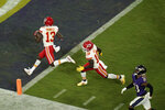 Kansas City Chiefs wide receiver Byron Pringle (13) rushes for a touchdown in the second half of an NFL football game against the Baltimore Ravens, Sunday, Sept. 19, 2021, in Baltimore. (AP Photo/Julio Cortez)