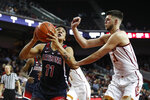 Arizona's Ira Lee, left, drives to the basket against Southern California's Nick Rakocevic during the second half of an NCAA college basketball game Thursday, Jan. 24, 2019, in Los Angeles. USC won 80-57. (AP Photo/Jae C. Hong)